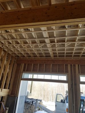 Before, During & After Garage Door Installation in Salem, MA We also performed framing work to custom fit the new tracks. (3)