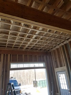 Before, During & After Garage Door Installation in Salem, MA We also performed framing work to custom fit the new tracks. (4)