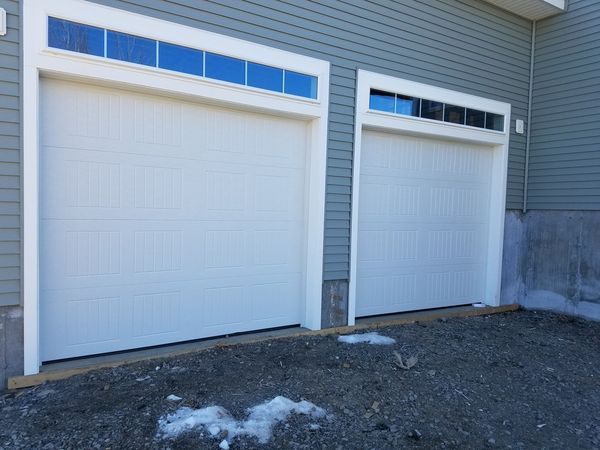 Before, During & After Garage Door Installation in Salem, MA We also performed framing work to custom fit the new tracks. (7)