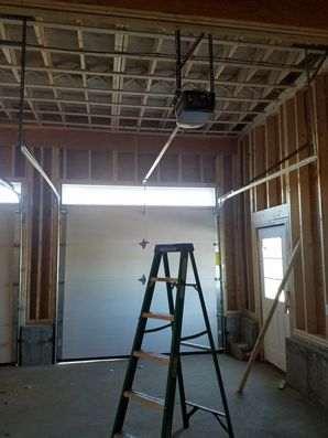 Before, During & After Garage Door Installation in Salem, MA We also performed framing work to custom fit the new tracks. (6)