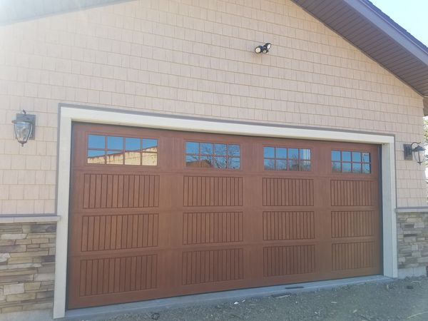 Garage Door Installation in Salem, MA Installed a fiberglass 18ft by 8ft door with windows and a Lift Master side opener. (7)